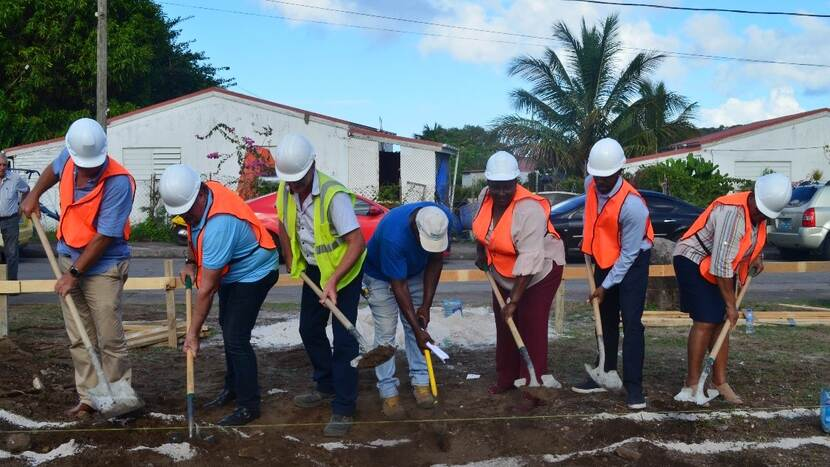 Breaking ground by Deputy Government Commissioner Alida Francis, Director Social Affairs Carol Jack, Director Liccom Henk van der Heuvel Director and Director Social Housing foundation Statia Jacquil Pandt.